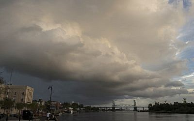 A large rain cloud passes over a day before the arrival of hurricane Florence in Wilmington, North Carolina, on September 12, 2018.(AFP PHOTO / ANDREW CABALLERO-REYNOLDS)