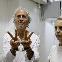 American-French law professor Frank Romano gestures at the Jerusalem court on September 16, 2018. To his right is his lawyer Gaby Lasky. US-born Romano, who teaches law at the Paris Nanterre University, was detained two days ago while taking part in a demonstration at the Bedouin village of Khan al-Ahmar, east of Jerusalem. (AFP PHOTO / Ahmad GHARABLI)