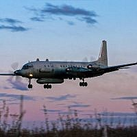 A photo taken on July 23, 2006 shows an Russian IL-20M (Ilyushin 20m) plane landing at an unknown location. Russia blamed Israel on September 18, 2018 for the loss of a military IL-20M jet to Syrian fire, which killed all 15 servicemen on board, and threatened a response.( AFP PHOTO / Nikita SHCHYUKIN)