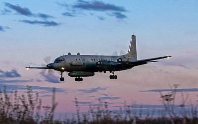 A photo taken on July 23, 2006 shows an Russian IL-20M (Ilyushin 20m) plane landing at an unknown location. ( AFP PHOTO / Nikita SHCHYUKIN)