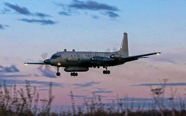 A photo taken on July 23, 2006 shows an Russian IL-20M (Ilyushin 20m) plane landing at an unknown location. Russia blamed Israel on September 18, 2018 for the loss of a military IL-20M jet to Syrian fire, which killed all 15 servicemen on board, and threatened a response. (AFP/Nikita Shchyukin)