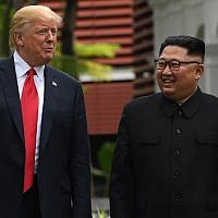 "In this file photo taken on June 11, 2018 North Korea's leader Kim Jong Un (R) walks with US President Donald Trump (L) during a break in talks at their historic US-North Korea summit, at the Capella Hotel on Sentosa island in Singapore. Trump on September 19, 2018 said US relations with North Korea are making ""tremendous progress"" from the days before his presidency when the two countries appeared close to ""going to war."" AFP PHOTO / SAUL LOEB)"