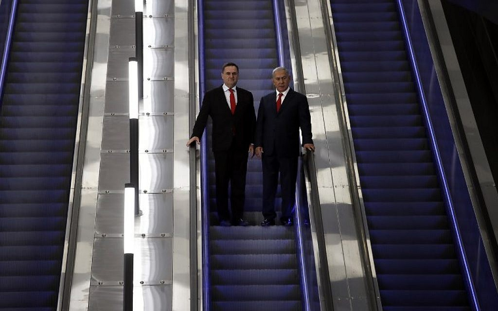 Israeli Prime Minister Benjamin Netanyahu (R) stands on an escalator next to Israel's Transportation and Intelligence Minister Yisrael Katz as they visit the new high-speed train between Jerusalem and Tel Aviv, at the Yitzhak Navon Railway Station in Jerusalem on September 20, 2018. (AFP PHOTO / THOMAS COEX)