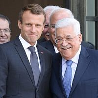 French President Emmanuel Macron (L) poses with Palestinian Authority President Mahmoud Abbas after their meeting with the French president at the Elysee Palace in Paris on September 21, 2018. (AFP/Ludovic Marin)