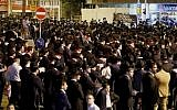 Ultra-Orthodox protesters block a road during a demonstration against light rail construction work on Shabbat on the outskirts of Bnei Brak, near Tel Aviv, on September 21, 2018. (AFP PHOTO / JACK GUEZ)
