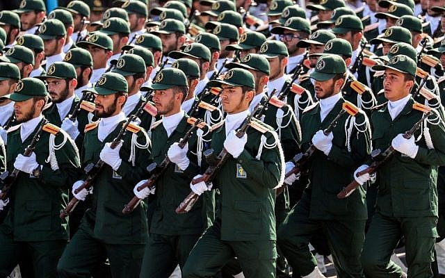Members of Iran's Revolutionary Guard Corps (IRGC) march during the annual military parade marking the anniversary of the outbreak of the 1980-1988 war with Iraq, in the capital Tehran on September 22, 2018. (AFP/STR)