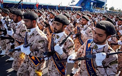 Illustrative: Members of Iran's Islamic Revolutionary Guard Corps (IRGC) march during the annual military parade, marking the anniversary of the outbreak of the devastating 1980-1988 war with Saddam Hussein's Iraq, in the capital Tehran, on September 22, 2018. (AFP/STR)