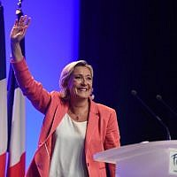 Leader of France's Rassemblement National (RN) far-right political party Marine Le Pen gestures during a party event in Mantes-la-Ville, outside Paris, on September 23, 2018.  (Lucas BARIOULET/AFP)