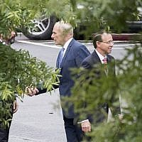 White House Chief of Staff John Kelly, center, shakes hands with an unidentified man as Assistant Attorney General Rod Rosenstein walks away after a meeting at the White House in Washington, DC, on September 24, 2018. (AFP/ Jim WATSON)