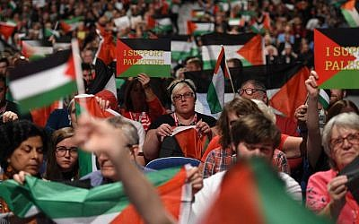 Illustrative: Delegates hold up Palestinian flags during a debate on the third day of the Labour party conference in Liverpool, northwest England on September 25, 2018. (AFP PHOTO / Oli SCARFF)