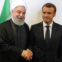 French President Emmanuel Macron meets with Iranian President Hassan Rouhani on the sidelines of the UN General Assembly at the UN headquarters on September 25, 2018, in New York. (AFP Photo/ludovic Marin)