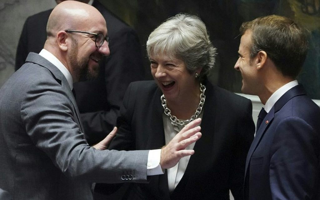 Belgian Prime Minister Charles Michel (L), British Prime Minister Theresa May and French President Emmanuel Macron are seen September 26, 2018 on the second day of the United Nations General Assembly in New York. (AFP PHOTO / Don EMMERT)