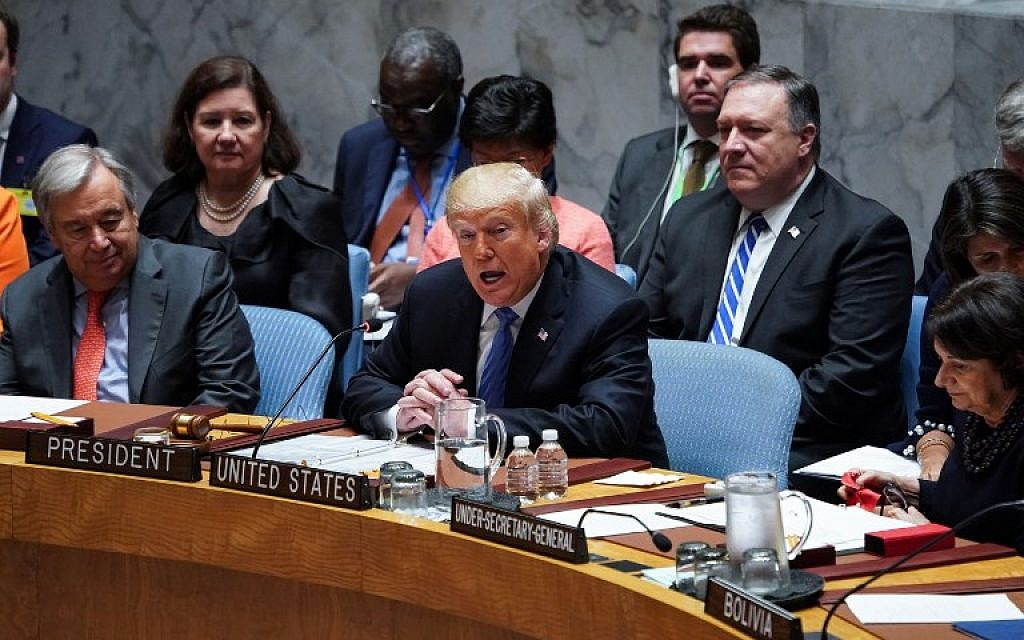 UN General Secretary Antonio Guterres (L) listens to US President Donald Trump as he opens the UN Security Council meeting on September 26, 2018 in New York on the sidelines of the UN General Assembly. (AFP PHOTO / Don EMMERT)