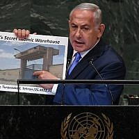 Prime Minister Benjamin Netanyahu addresses the General Assembly at the United Nations in New York September 27, 2018, holding up a picture of an alleged Iranian 'atomic warehouse (Timothy A. Clary/AFP)