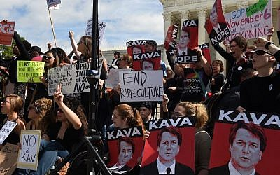 Activist demonstrate against US Supreme Court nominee Brett Kavanaugh in front of the court in Washington, DC, on September 28, 2018. (AFP/Eric BARADAT)