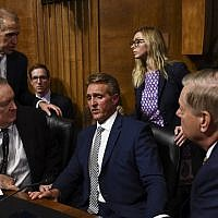 Senate Judiciary Committee member Senator Jeff Flake, center, speaks with colleagues after a hearing on Capitol Hill in Washington, DC on September 28, 2018,. (AFP/ Brendan Smialowski)