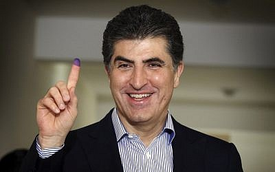 Nechirvan Barzani, prime minister of Iraq's autonomous Kurdistan Regional Government (KRG), shows his ink-stained index finger after casting his ballot for the parliamentary election at a polling station in Erbil, the capital of the Kurdish autonomous region in northern Iraq, on September 30, 2018. (AFP PHOTO / SAFIN HAMED)