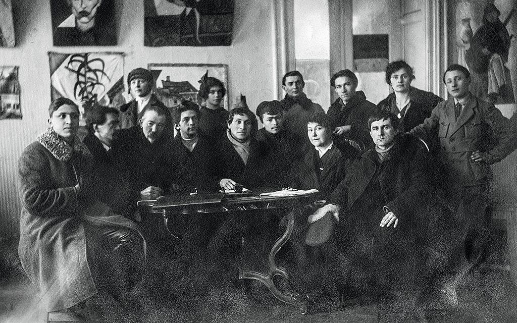 Members of the Creative Committee of the People's Art School, Vitebsk, winter 1919. Seated: Yuri (Yehuda) Pen (third from left), Marc Chagall (center), Vera Ermolaeva (second from right), Kazimir Malevich right). Gelatin silver print. (Archives Marc et Ida Chagall, Paris)