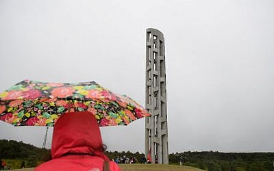 The Tower of Voices stands above visitors, dignitaries and family members of the victims of Flight 93 at the Flight 93 National Memorial on September 9, 2018 in Shanksville, Pennsylvania.  (Jeff Swensen/Getty Images/AFP)