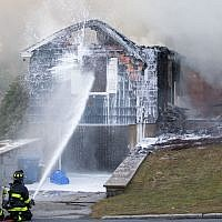 Firefighters work to extinguish a blaze caused by over pressurized gas lines on September 13, 2018 in Lawrence, Massachusetts. (Scott Eisen/Getty Images/AFP)