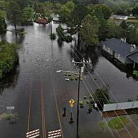 Flood waters from Hurricane Florence surround a house and flow along the street in Fayetteville, North Carolina, on September 16, 2018. (Joe Raedle/Getty Images/AFP)