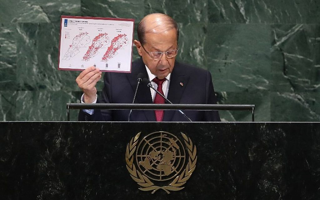 : Lebanese President Michel Aoun shows a timeline of the growth in number of Syrian refugees in Lebanon while addressing the United Nations General Assembly on September 26, 2018 in New York City. ( John Moore/Getty Images/AFP)