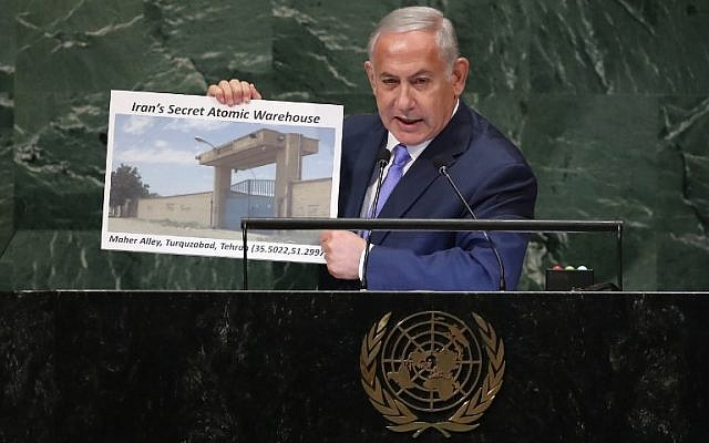 Benjamin Netanyahu addresses the United Nations General Assembly on September 27, 2018, in New York City, and holds up a picture of what he said was a secret Iranian nuclear warehouse. (John Moore/Getty Images/AFP)