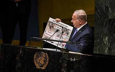 Benjamin Netanyahu holds up a placard of suspected Iranian atomic sites while delivering a speech at the United Nations during the United Nations General Assembly on September 27, 2018 in New York City. (Stephanie Keith/Getty Images/AFP)
