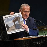 Prime Minister Benjamin Netanyahu holds up a placard showing a suspected Iranian atomic site while delivering a speech at the United Nations during the United Nations General Assembly on September 27, 2018 in New York City. (Stephanie Keith/Getty Images/AFP)