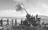 Israeli troops fire a cannon from a position on the Golan Heights during the Yom Kippur War on October 11, 1973. (Radovan Zeev/Bamahane/Defense Ministry Archives)