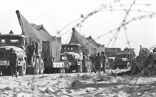 Israeli military vehicles take positions on the Sinai Peninsula during the start of the Yom Kippur War on October 6, 1973. (Avi Simhoni/Bamahane/Defense Ministry Archives)