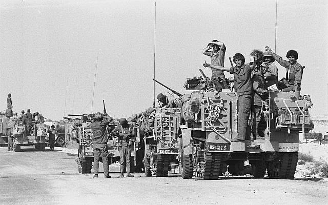Israeli armored vehicles take positions on the Sinai Peninsula during the start of the Yom Kippur War on October 6, 1973. (Avi Simhoni/Bamahane/Defense Ministry Archives)