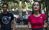 In this Wednesday, August 15, 2018, photo, Democratic New York state Senate candidate Julia Salazar speaks during a rally in McCarren Park in the Brooklyn borough of New York. (AP Photo/Mary Altaffer)