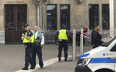 Dutch police officers near the scene of a stabbing attack near the Central Station in Amsterdam, the Netherlands, on August 31, 2018. (AP Photo/Alex Furtula)