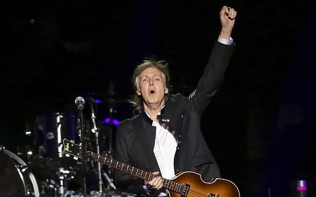 In this September 11, 2017, photo, singer/songwriter Paul McCartney performs on stage at the Prudential Center in Newark, New Jersey. (Brent N. Clarke/Invision/AP)