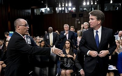 Fred Guttenberg, the father of Jamie Guttenberg who was killed in the Stoneman Douglas High School shooting in Parkland, Florida., left, attempts to shake hands with Supreme Court nominee, Brett Kavanaugh on Capitol Hill in Washington, September 4, 2018 (AP Photo/Andrew Harnik)
