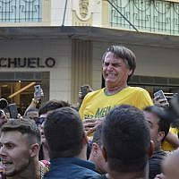 Presidential candidate Jair Bolsonaro grimaces right after being stabbed in the stomach during a campaign rally in Juiz de Fora, Brazil, Thursday, Sept. 6, 2018. (AP/Raysa Leite)