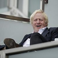 Britain's former foreign secretary Boris Johnson reacts to seeing photographers taking his picture as attends the fifth cricket test match of a five match series between England and India at the Oval cricket ground in London, September 8, 2018.  (AP Photo/Matt Dunham)
