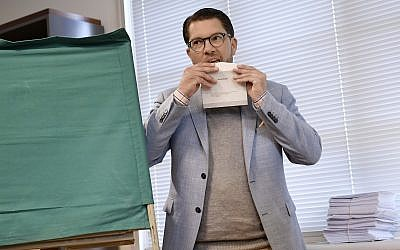 Jimmie Akesson, leader of the right-wing nationalist Sweden Democrats party, prepares to vote in Stockholm, Sweden, Sunday Sept. 9, 2018.  (Stina Stjernkvist/TT via AP)