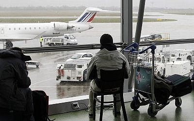 In this Dec.17, 2011 file photo, a passenger waits for his flight during at Lyon's Saint Exupery airport, central France (AP Photo/Laurent Cipriani, File)