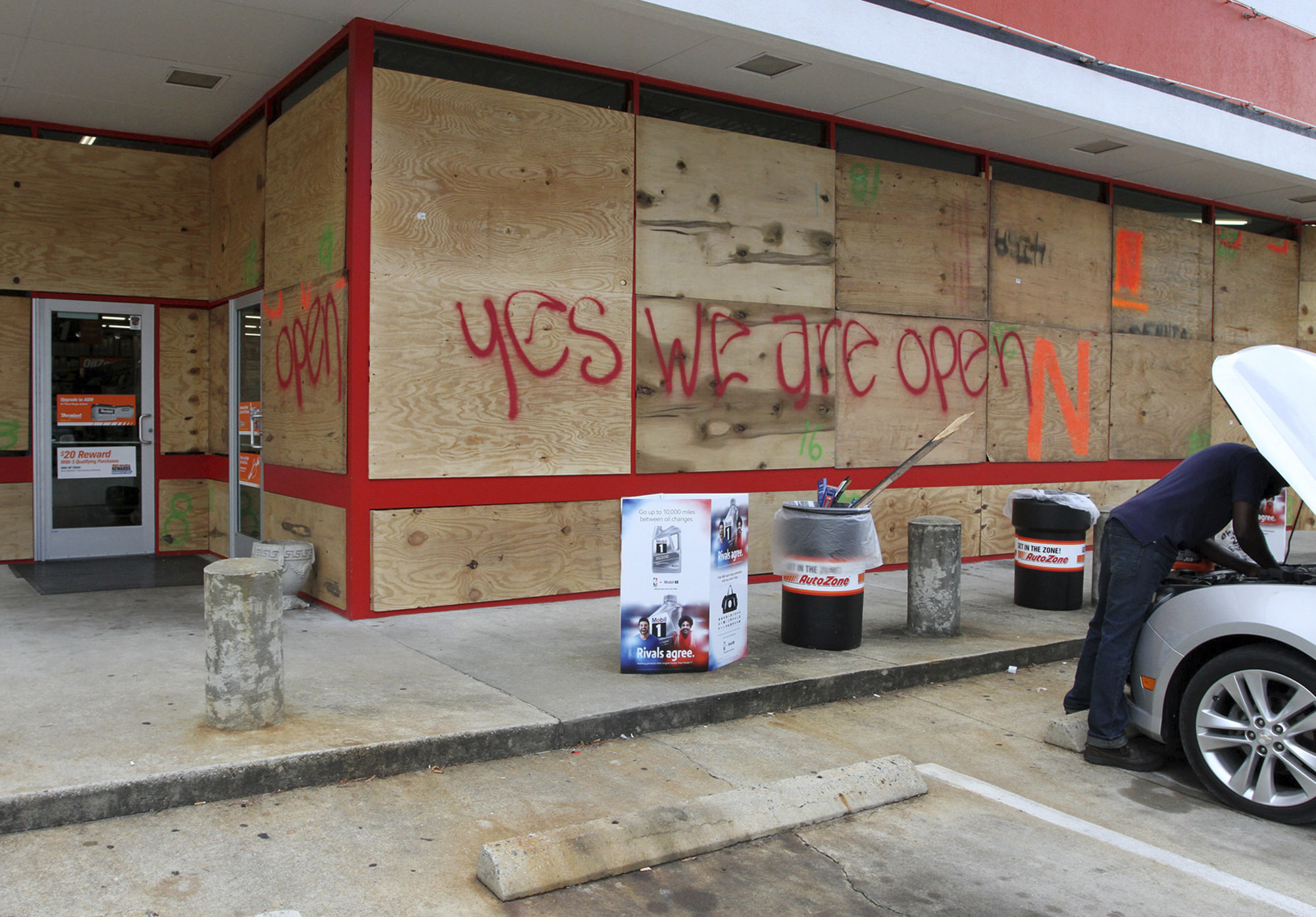 An auto parts store has wood paneling installed over the windows Tuesday Sept. 11 2018 in New Bern N.C. as a precaution against storm damage from Hurricane Florence