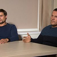 In this video grab provided by the RT channel , Ruslan Boshirov, left, and Alexander Petrov attend their first public appearance in an interview with the Kremlin-funded RT channel in Moscow, Russia, September 13, 2018. (RT channel video via AP)