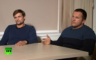 In this video grab provided by the RT channel, Ruslan Boshirov, left, and Alexander Petrov attend their first public appearance in an interview with the Kremlin-funded RT channel in Moscow, Russia, September 13, 2018. (RT channel video via AP)