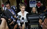 New York gubernatorial candidate Cynthia Nixon, center, speaks to members of the media outside a polling station after voting in the primary, September 13, 2018, in New York. (AP Photo/Bebeto Matthews)