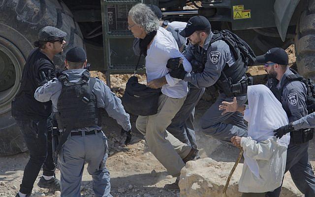 Israeli border police arrest American university professor Frank Romano in the West Bank Bedouin community of Khan al-Ahmar on September 14, 2018 (AP Photo/Nasser Nasser, File)