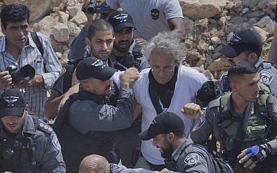 Israeli police arrest French-American law professor Frank Romano in the West Bank Bedouin community of Khan al-Ahmar on September 14, 2018. (AP Photo/Nasser Nasser)