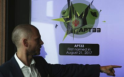 Alister Shepherd, the director of a subsidiary of the cybersecurity firm FireEye, gestures during a presentation about the APT33 hacking group, which his firm suspects are Iranian government-aligned hackers, in Dubai, United Arab Emirates, on September 18, 2018. (AP Photo/Jon Gambrell)