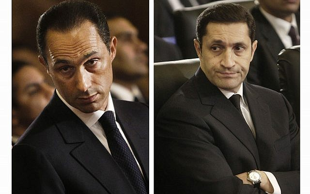 This combination of Jan. 6, 2011 file images shows Gamal Mubarak, left, and Alaa Mubarak, right, attending a Christmas Eve Mass at the Coptic cathedral in Cairo, Egypt. (AP Photo/File)