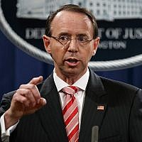 "In this July 13, 2018, file photo, Deputy Attorney General Rod Rosenstein speaks during a news conference at the Department of Justice in Washington. Rosenstein is denying a report in The New York Times that he suggested last year that he secretly record President Donald Trump in the White House to expose the chaos in the administration. Rosenstein says the story is ""inaccurate and factually incorrect."" (AP Photo/Evan Vucci)"