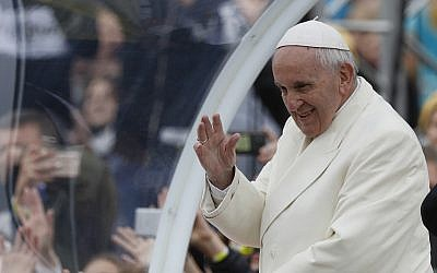 Pope Francis greets the crowd on his Popemobile as he arrives for a meeting with youths at the Cathedral Square in Vilnius, Lithuania, September 22, 2018. (AP Photo/Mindaugas Kulbis)